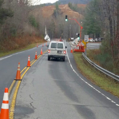 Road Cones Mark Repair Area and Divide Lanes to Divert Traffic Safely