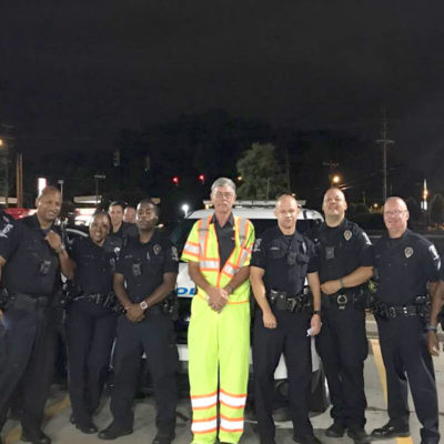 Police Appreciating Bird Dog Traffic Control Team at Worksite