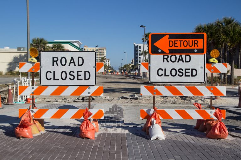 Road Closed and Detour Signs Divert Traffic