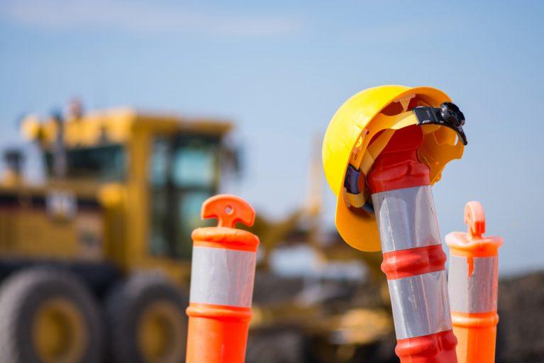 Construction Worker Helmet in Front of Construction Zone