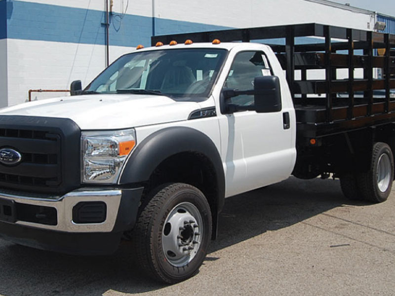 Bird Dog Traffic Control's Stake Body Truck is available for rentals in Texas.